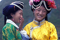 """Mosuo women in traditional costume at the fertility festival dedicated to the God Ganmo. At the festival women are able to select a mate and it is one of the highlights of the Mosuo calander. Women from the Mosuo tribe do not marry, take as many lovers as they wish and have no word for """"father"""" or """"husband"""". But the arrival of tourism and the sex industry is changing their culture...PHOTO BY SINOPIX"""