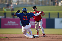 Salem Red Sox second baseman Nick Yorke (3) turns a double play as Luis Mieses (21) of the Kannapolis Cannon Ballers slides into second base at Atrium Health Ballpark on July 29, 2021 in Kannapolis, North Carolina. (Brian Westerholt/Four Seam Images)