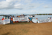"Altamira, Brazil. ""Xingu Vivo Para Sempre"" protest meeting about the proposed Belo Monte hydroeletric dam and other dams on the Xingu river and its tributaries. ""Respect the people of the forest"" banner."