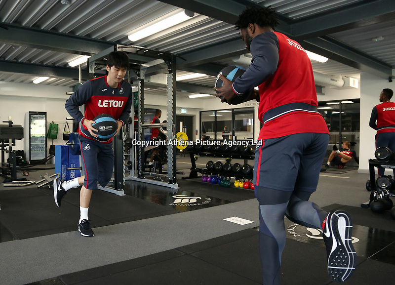 (L-R) Ki Sung-Yueng and Wilfried Bony exercise in the gym during the Swansea City Training at The Fairwood Training Ground, Swansea, Wales, UK. Wednesday 01 November 2017