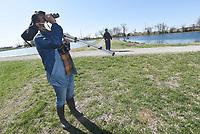 Vivek Govind Kumar (left) and Joe Neal look at birds in March 2021 at the state fish hatchery.<br />(NWA Democrat-Gazette/Flip Putthoff)