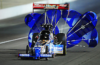 Oct. 28 2011; Las Vegas, NV, USA: NHRA top fuel dragster driver T.J. Zizzo during qualifying for the Big O Tires Nationals at The Strip at Las Vegas Motor Speedway. Mandatory Credit: Mark J. Rebilas-US PRESSWIRE