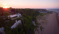 BNPS.co.uk (01202 558833)<br /> Pic: Strutt&Parker/BNPS<br /> <br /> Sunrise...<br /> <br /> A former WW2 battery, with unrivalled views across the channel to France, has come on the market - but you'll need deep pockets to shell out on its stunning location.<br /> <br /> The cliff top gun emplacement was rapidly constructed in 1940, as Britsh troops were fleeing Dunkirk, and has now been transformed into a £6million 'James Bond style' property.<br /> <br /> The Gunnery, near Kingsdown in Kent offers 'incredible' views of the Channel, with the iconic White Cliffs of Dover visible to the west, and France to the south, while also coming with six acres of sandy beach.<br /> <br /> The unique 82ft long property is accessed by an underground tunnel that leads through the cliff to a glass lift which travels up to it. Another secret tunnel inside the four bedroom home, which is just a few feet from the cliff edge, provides passage to a home cinema.<br /> <br /> The 50ft long living room has floor to ceiling windows and the original gun loops can still be seen.