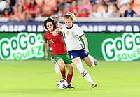 HOUSTON, TX - JUNE 10: Samantha Mewis #3 of the United States and Dolores Silva #14 of Portugal battle for control of the ball during a game between Portugal and USWNT at BBVA Stadium on June 10, 2021 in Houston, Texas.