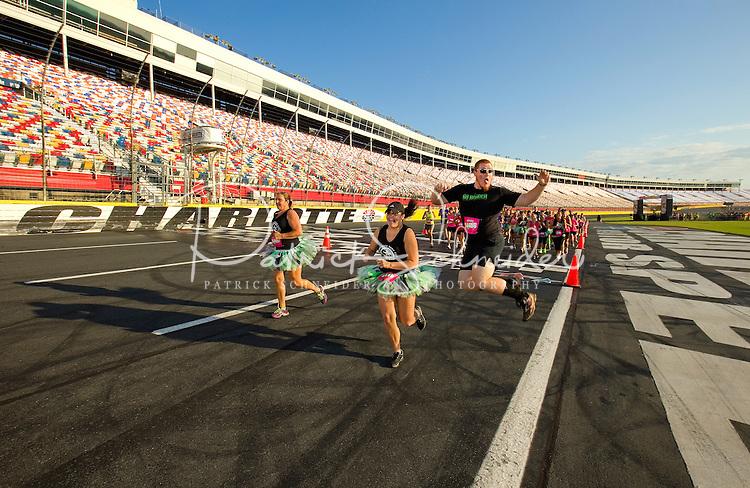 Thousands of people took part in the Charlotte ROC Race - 5k Ridiculous Obstacle Challenge held at Charlotte Motor Speedway in Charlotte, NC. The ROC Race combines a 5K course with game show inspired obstacles to give you the craziest run.<br /> <br /> Photo by: Patrick SchneiderPhoto.com