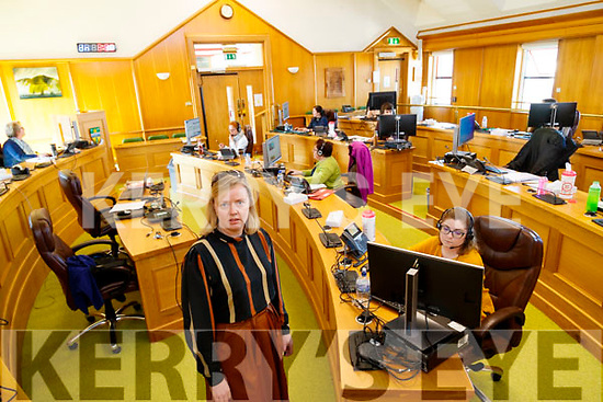 Gene Foley in foreground with Kerry County Council staff working in the Call cetnre set up in the Council chamber.