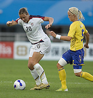 USA forward (20) Abby Wambach dribbles away from Sweden midfielder (5) Caroline Seger during their Group B first round game at the 2007 FIFA Women's World Cup at Chengdu Sports Center Stadium in Chengdu, China, on September 14, 2007. The United States (USA) defeated Sweden (SWE), 2-0.