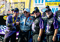 Sep 15, 2019; Mohnton, PA, USA; NHRA funny car driver John Force (center) with driver Jack Beckman and crew during the Reading Nationals at Maple Grove Raceway. Mandatory Credit: Mark J. Rebilas-USA TODAY Sports
