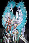 Rio de Janeiro, Brazil. Carnival samba school parade; girls in silver and turquoise feather costumes on a float.