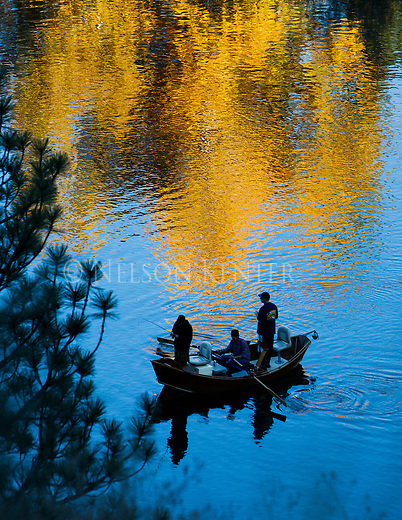 Fishermen in a drift boat on the Clark Fork River outside of Missoula, Montana on a fall day.