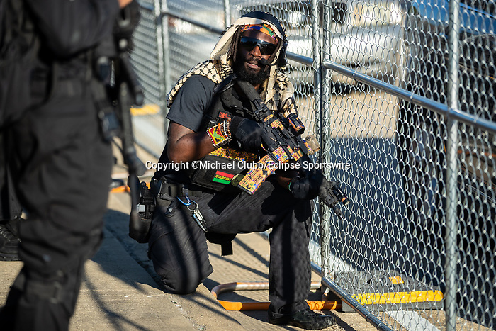 """September 5, 2020:  A member of the NFAC kneels down on the ground outside of Churchill Downs  the 146th Kentucky Derby. With the Kentucky Derby being the biggest sports event for the State of Kentucky, protestors have chosen the  event as a focal point for their calls for justice in the death of Breonna Taylor. Multiple groups from around the country have converged on Louisville to protest during the """"Run for the Roses"""" at Churchill Downs in Louisville. Michael Clubb/Eclipse Sportswire/CSM"""