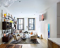 The living room is designed as though a work of art with white walls punctuated by doorways that peek into wonder-world pod bedrooms. There is no art on the wall because the wall itself has its own graphic beauty, especially when the northern light pours in. The furniture includes pieces by Joe Colombo and Verner Panton.