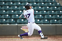 Daniel Gonzalez (17) of the Winston-Salem Rayados follows through on his swing against the Potomac Nationals at BB&T Ballpark on August 12, 2018 in Winston-Salem, North Carolina. The Rayados defeated the Nationals 6-3. (Brian Westerholt/Four Seam Images)