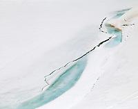 Melting ice on Summit Lake, Mount Evans