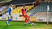 Blackpool's Gary Madine shields the ball from Peterborough United's Frankie Kent, left, and Peterborough United's Ryan Broom<br /> <br /> Photographer Chris Vaughan/CameraSport<br /> <br /> The EFL Sky Bet League One - Peterborough United v Blackpool - Saturday 21st November 2020 - London Road Stadium - Peterborough<br /> <br /> World Copyright © 2020 CameraSport. All rights reserved. 43 Linden Ave. Countesthorpe. Leicester. England. LE8 5PG - Tel: +44 (0) 116 277 4147 - admin@camerasport.com - www.camerasport.com