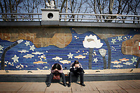 CHINA. Jiangxi Province.  Jiujiang. A man and woman in front of an aquatic themed mural. Jiujiang is a city of 4.6 million people, located on the southern shore of the Yangtze River. The Yangtze River is reported to be at its lowest level in 150 years as a result of a country-wide drought. It is China's longest river and the third longest in the world. Originating in Tibet, the river flows for 3,964 miles (6,380km) through central China into the East China Sea at Shanghai.  2008