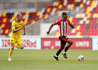 6th September 2020; Brentford Community Stadium, London, England; English Football League Cup, Carabao Cup, Football, Brentford FC versus Wycombe Wanderers; Ivan Toney of Brentford sprinting away from Jack Grimmer of Wycombe Wanderers