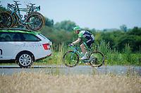 Bauke Mollema (NLD/Belkin) trailing the team car, trying to catch up to the peloton after a crash where he had to change his bike (no race number)<br /> <br /> 2014 Tour de France<br /> stage 4: Le Touquet-Paris-Plage/Lille Métropole (163km)