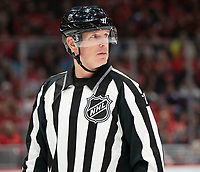 WASHINGTON, DC - JANUARY 31: Linesman Brad Kovachik #71 at the face off circle during a game between New York Islanders and Washington Capitals at Capital One Arena on January 31, 2020 in Washington, DC.