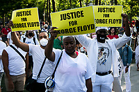 NEW YORK, USA - May 25: Protesters in support of Black Lives Matteren gather with banners in Cadman Plaza Park on the first anniversary of the death on May 25, 2021 in New York City. George Floyd's assassination in Minneapolis sparked a worldwide outcry and continued to propel the Black Lives Matter movement through different cities in the United States and the world. (Photo by Pablo Monsalve / VIEWpress via Getty Images)