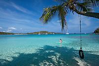 Young woman in the water at Gibney / Oppenheimer Beach near the tire swing.Virgin Islands National Park.St. John.U.S. Virgin Islands