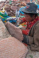 A Tibetan at Lake Namtso carving Mani stone plates, rocks and/or pebbles, inscribed with the six syllabled mantra Creating and carving mani stones as devotional or intentional process art under the influence of Tibetan Buddhism. The mantra of Avalokiteshvara is also a common design on prayer wheels.