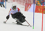 Kimberly Joines, Sochi 2014 - Para Alpine Skiing // Para-ski alpin.<br /> Kimberly Joines competes in the women's slalom sitting event // Kimberly Joines participe au slalom assise féminin. 12/03/2014.