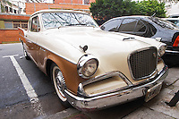A Studebaker Silver Hawk Classic Car parked on a street, painted in cream white and brown, ca 1950s 50s, detail of front and head light headlight 1950 50 Buenos Aires Argentina, South America