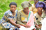 Community Health Workers during a morning of training on the lawn at Rukumo Health Center, Rwanda....