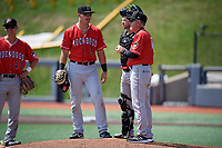 Batavia Muckdogs manager Tom Lawless (10) talks with Nic Ready (5), catcher Dustin Skelton (6), and Jack Strunc (47) while making a pitching change during a NY-Penn League game against the West Virginia Black Bears on August 29, 2019 at Monongalia County Ballpark in Morgantown, New York.  West Virginia defeated Batavia 5-4 in ten innings.  (Mike Janes/Four Seam Images)