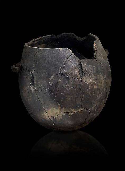 Neolithic terracotta pot . Catalhoyuk collection, Konya Archaeological Museum, Turkey. Against a black background