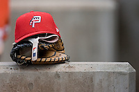 A Potomac Nationals hat sits atop a glove in the visitors dugout at Ernie Shore Field in Winston-Salem, NC, Saturday August 9, 2008. (Photo by Brian Westerholt / Four Seam Images)