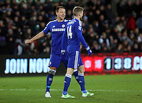 Swansea, UK Saturday 17 January 2015 <br /> Andre Schurrle (R) of Chelsea celebrating his goal with team mate John Terry (L) making the score Swansea 0-5 Chelsea<br /> Barclays Premier League, Swansea City FC v Chelsea at the Liberty Stadium, south Wales, UK
