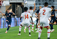 WASHINGTON, DC - SEPTEMBER 6: Virginia defender Paul Wiese (4) sends a cross over the Maryland defense during a game between University of Virginia and University of maryland at Audi Field on September 6, 2021 in Washington, DC.
