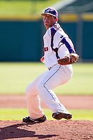 Kyle Lloyd (35) of the Evansville Purple Aces winds up during a game against the Indiana State Sycamores in the 2012 Missouri Valley Conference Championship Tournament at Hammons Field on May 23, 2012 in Springfield, Missouri. (David Welker/Four Seam Images)