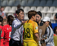 GRENOBLE, FRANCE - JUNE 12: Dukyeo Yoon coach of the Korean National Team supports Minjung Kim #18 of the Korean National Team during a game between Korea Republic and Nigeria at Stade des Alpes on June 12, 2019 in Grenoble, France.