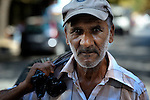 Sadedin Husein, 63, is a Roma man who lives in the mostly Roma town of Suto Orizari, Macedonia, but spends his days at work collecting plastic bottles in the streets of Skopje, which he sells to recyclers. Here he walks along the streets of Skopje with his bag of plastic bottles.
