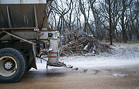 Corbin Elders uses a haul truck to spread sand, Friday, February 12, 2021 along a dirt road at Phillip's Cemetery in Lowell. Check out nwaonline.com/210213Daily/ for today's photo gallery. <br /> (NWA Democrat-Gazette/Charlie Kaijo)