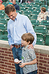 2011 Kentucky Derby winning trainer H. Graham Motion and son Marcus prepare to throw out the first pitch at Camden Yards in Baltimore, MD.