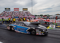 Aug 30, 2014; Clermont, IN, USA; NHRA pro stock driver Jonathan Gray (near lane) races alongside V. Gaines during qualifying for the US Nationals at Lucas Oil Raceway. Mandatory Credit: Mark J. Rebilas-USA TODAY Sports