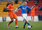 St Johnstone v Kilmarnock.....28.02.15<br /> Steven Anderson gets away from Josh Magennis<br /> Picture by Graeme Hart.<br /> Copyright Perthshire Picture Agency<br /> Tel: 01738 623350  Mobile: 07990 594431