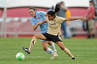 Marta (10) of FC Gold Pride looks to hold off Danielle Johnson (15) of Sky Blue FC. FC Gold Pride defeated Sky Blue FC 1-0 during a Women's Professional Soccer (WPS) match at Yurcak Field in Piscataway, NJ, on May 1, 2010.