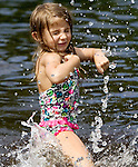 WOLCOTT CT. 17 August 2015-081715SV02-Juliana Thomcheski, 5, of Wolcott enjoys cooling off in the water at the Woodtick Recreation area in Wolcott Monday. <br /> Steven Valenti Republican-American