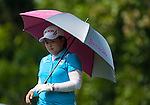 TAOYUAN, TAIWAN - OCTOBER 26:  Inbee Park of South Korea shelters from the sun under an umbrella on the 9th tee during the day two of the Sunrise LPGA Taiwan Championship at the Sunrise Golf Course on October 26, 2012 in Taoyuan, Taiwan. Photo by Victor Fraile / The Power of Sport Images
