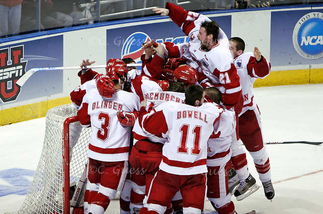 Junior Andy Brandt jumps over his teammates in celebration seconds after the UW Men?s Hockey team won the national championship against Boston College at the Bradley Center in Milwaukee, Wis.