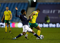 2nd February 2021; The Den, Bermondsey, London, England; English Championship Football, Millwall Football Club versus Norwich City; Mahlon Romeo of Millwall challenges Onel Hernandez of Norwich City