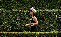 A women carries a pair of binoculars during the Queen's Cup Steeplechase in Mineral Springs, NC.