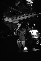 This quartet performs in the basement of the Hotel Bentley. The hotel has been a part of the local entertainment in the city for decades and stays true to the jazz and blues music scene. Alexandria,  Louisiana,December 2003 © Stephen Blake Farrington