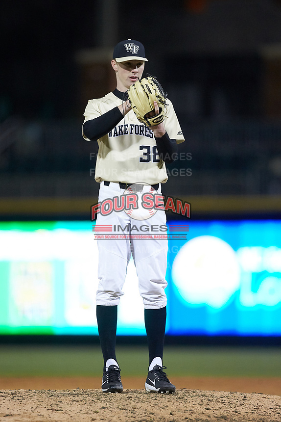 Wake Forest Demon Deacons relief pitcher William Fleming (38) looks to his catcher for the sign against the Charlotte 49ers at BB&T BallPark on March 13, 2018 in Charlotte, North Carolina.  The 49ers defeated the Demon Deacons 13-1.  (Brian Westerholt/Four Seam Images)