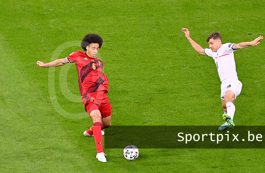 Belgian midfielder Axel Witsel (6) pictured in a duel during a soccer game during the quarter final Euro 2020 European Championship between the Belgian national soccer team Red Devils and Italy , called the Azzurri , on friday 2 nd of July 2021  in the Allianz Arena in Munchen , Germany . PHOTO SPORTPIX | SPP | DAVID CATRY